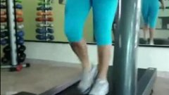 Sexy woman in tight pants at the gym shows camel toe