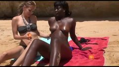 Amateur threesome sex at the beach with white girl and black girl