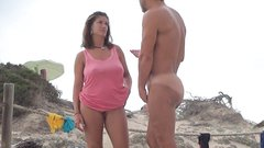Gorgeous MILF undressing totally nude at the beach filmed voyeur