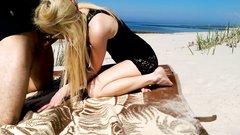 Blonde teen sucks and fucks at public beach