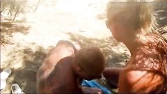 Slut blonde takes multiple cum in mouth from strangers at the beach