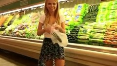Public nudity in store an exhibitionist girl playing with cucumber